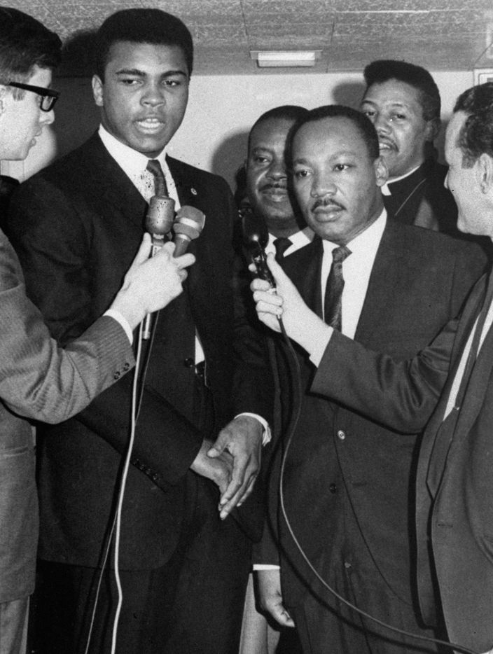 In this March 29, 1967 file photo, heavyweight boxing champion Muhammad Ali, left, and Dr. Martin Luther King speak with reporters in Louisville, Ky. King says the sooner this country does away with the draft, the better off we'll be. Ali was here for his court hearing to prevent his Army induction on April 28 in Houston.