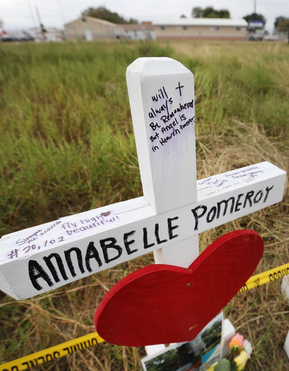 A wooden cross near First Baptist Church in Sutherland Springs honors 14-year-old Annabelle Pomeroy.