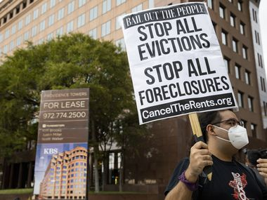 """Dariel Hernandez protests outside of the office of Senator John Cornyn """"to show him the reality of the eviction crisis"""" on Sept. 1, 2020 in Dallas."""