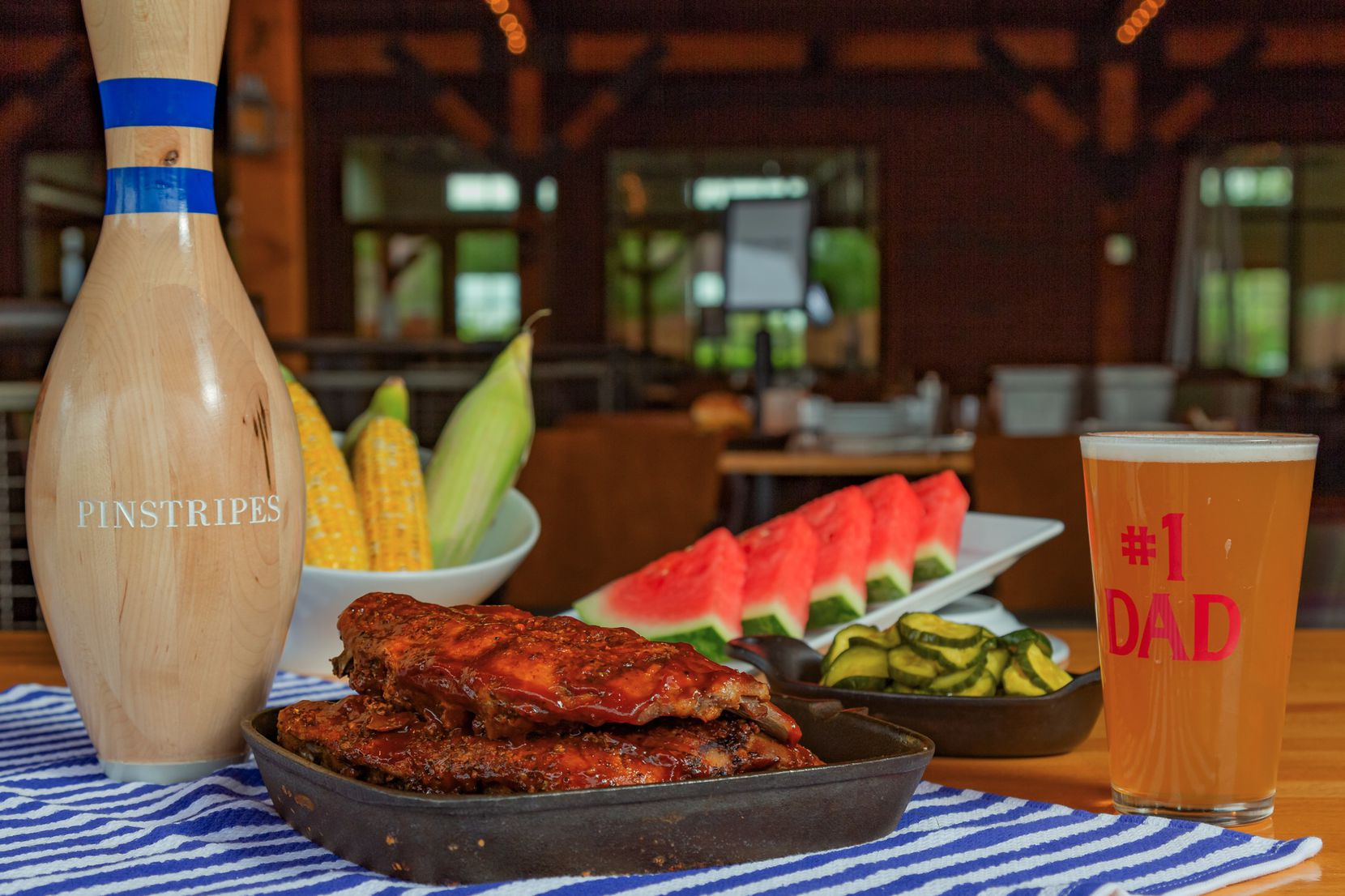 Pinstripes's Father's Day all-you-can-eat barbecue menu includes balsamic barbecue ribs, grilled corn on the cob, fresh watermelon slices and pickles.