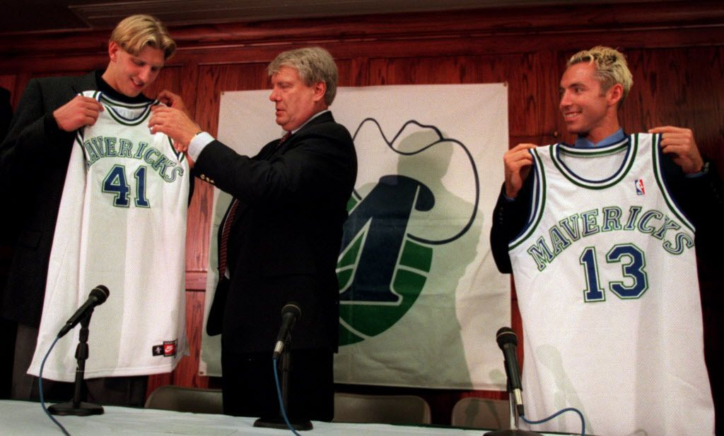 Mavericks head coach Don Nelson, center, presents first-round draft choice Dirk Nowitzki, left, and newly acquired guard Steve Nash with jerseys at a press conference in Dallas on June 29, 1998.