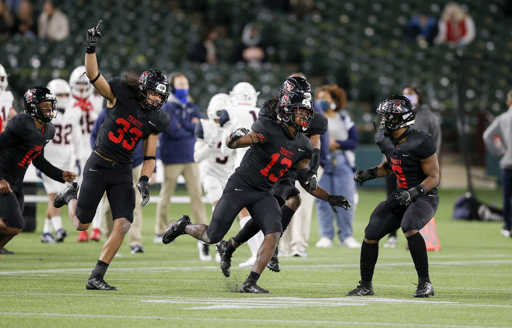 Euless Trinity junior defensive back Jacob Schaeffer (13) celebrates intercepting a pass during the second half of a high school Class 6A Division I Region I semifinal football game against Allen at Globe Life Park in Arlington, Saturday, December 26, 2020. Trinity won 49-45. (Brandon Wade/Special Contributor)