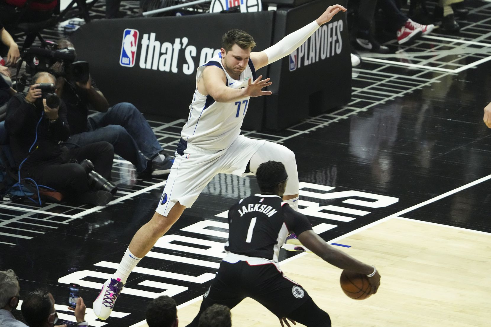 Dallas Mavericks guard Luka Doncic (77) defends against LA Clippers guard Reggie Jackson (1) during the first quarter of Game 7 of an NBA playoff series at the Staples Center on Sunday, June 6, 2021, in Los Angeles.
