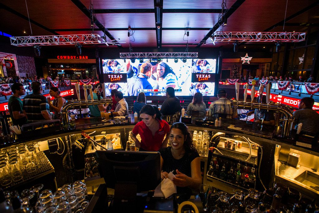 Texas Live revolves around a central open space known as the Live Arena (pictured), which boasts a 100-foot video screen for optimal sports watching.