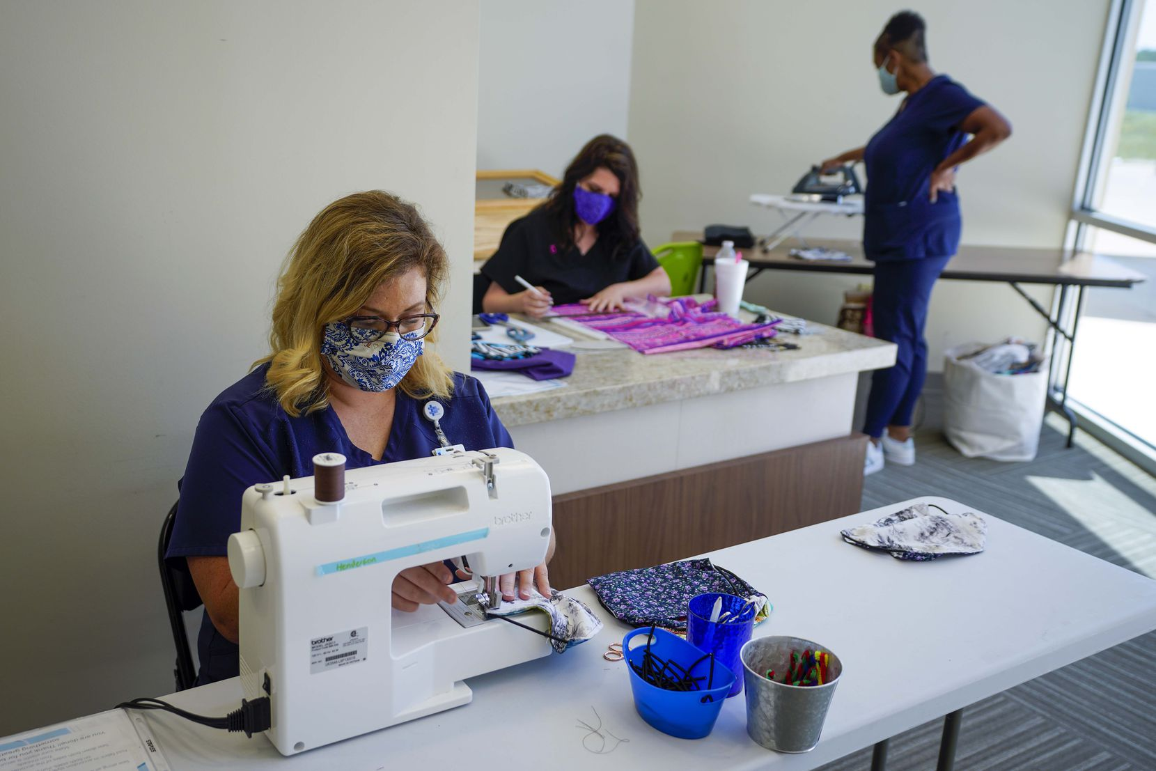 Faith Community Hospital staff members (from left) Mikey McBride, Sarah Bullock and Dionne Collins make face masks at the hospital in Jacksboro.