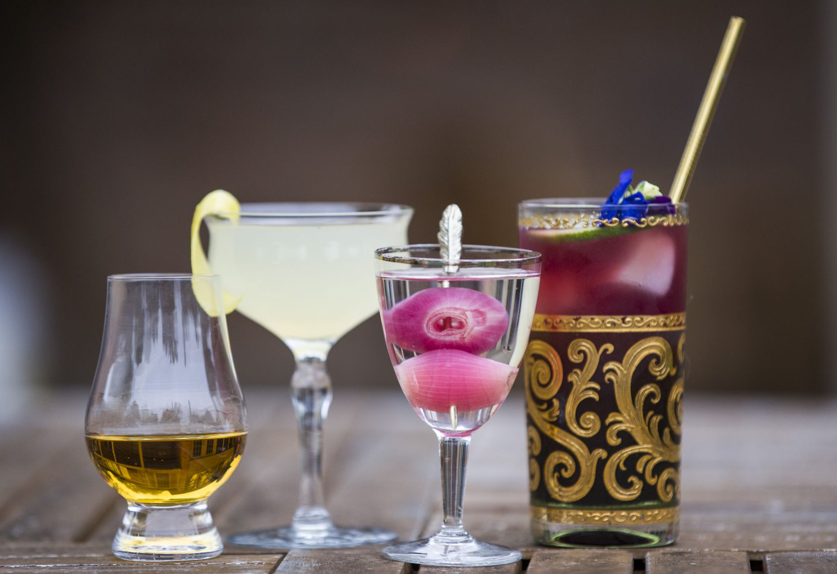 """Among the drinks Jones and Rivera have featured in their """"LesBnb"""" series: A pour of whiskey, a French 75, a Gibson martini and a Thrice and Elder, photographed at their home on Friday, April 3, 2020 in Dallas. The couple is among a number of spirits industry workers making drink videos to stay busy, creative and connected to their tight-knit-community. (Ashley Landis/The Dallas Morning News)"""