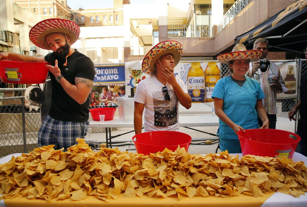 In celebration of Cinco De Mayo, Mattito's restaurant in the Uptown area of Dallas held a queso eating competition, Thursday, May 5, 2016. Competitors from left, winner Bradley Johnson, second place finisher Victor Gorostieta, and Yaseming Medina prepare to devour queso.  (Tom Fox/The Dallas Morning News)