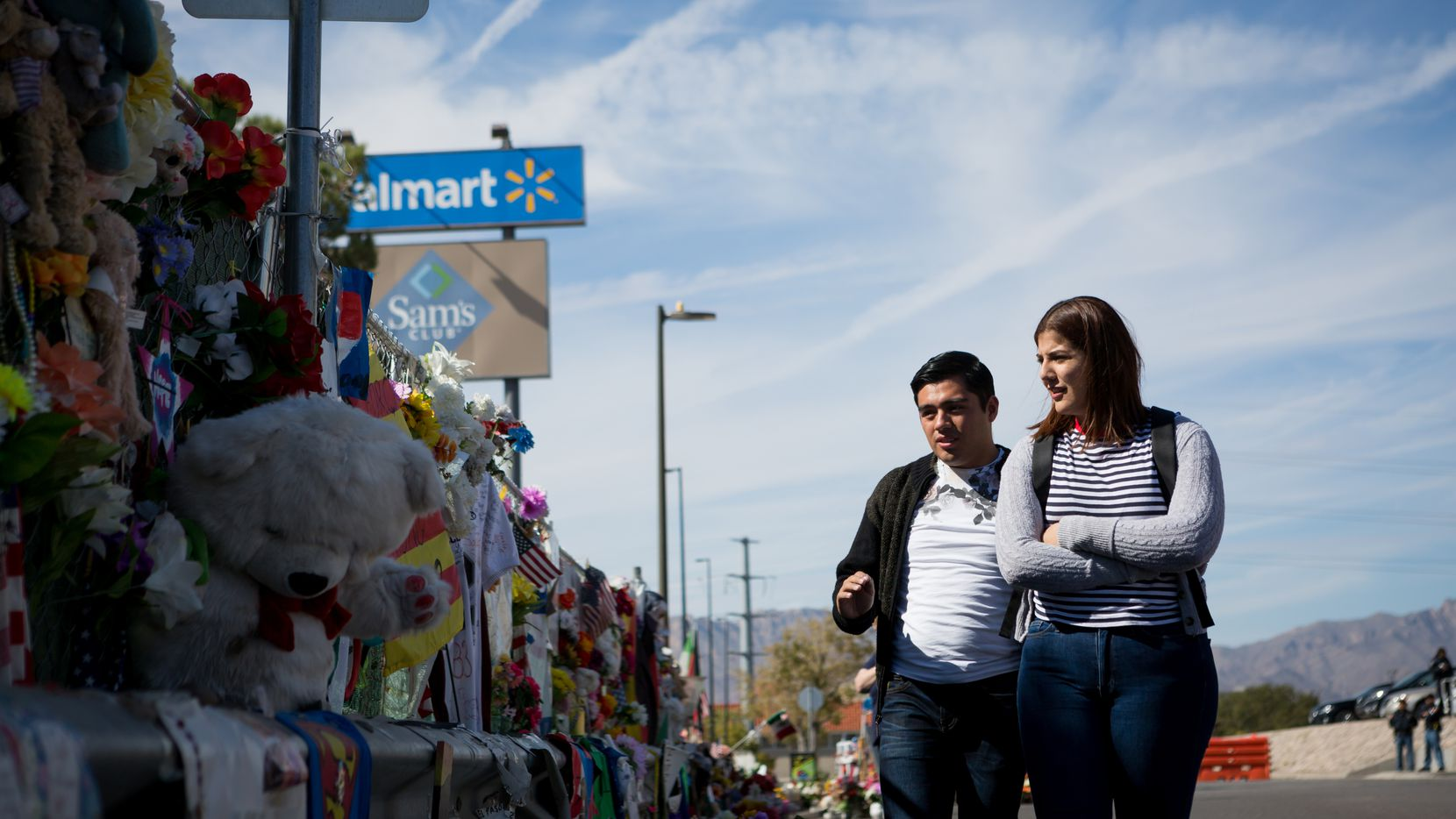 Gaddiel Antonio and Diana Castaneda, from Juarez, Mexico, visit the memorial that honors victims of the Walmart mass shooting for Dia de los Muertos in El Paso on Saturday, Nov. 2, 2019.
