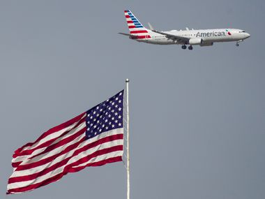 An American Airlines 737 descends for a landing at DFW International Airport.