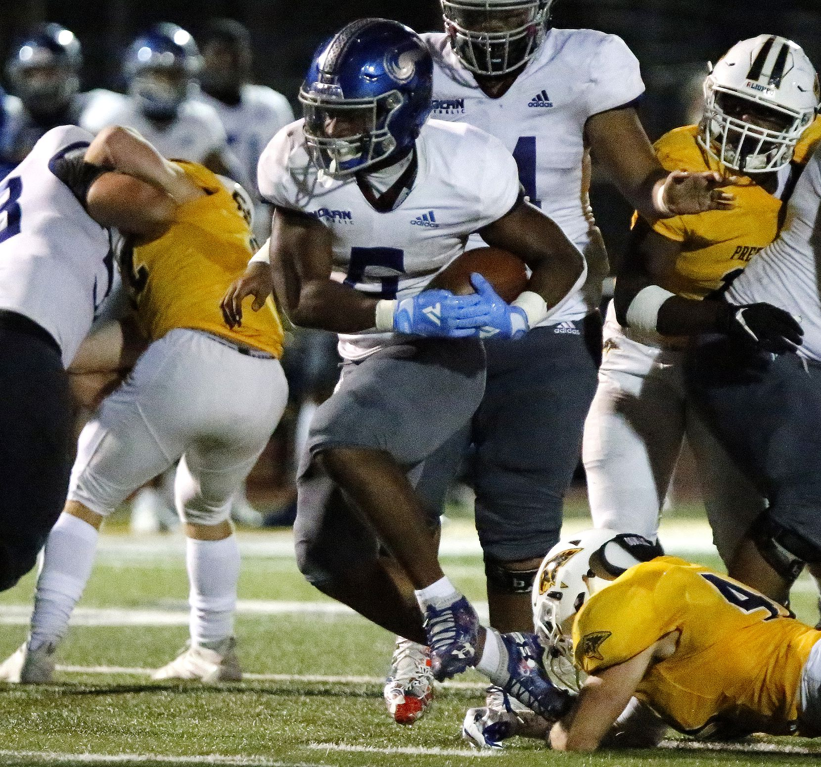 Nolan Catholic High School running back Emeka Megwa (6) scored a touchdown on this run after breaking a tackle attempt by Prestonwood Christian Academy linebacker Cole Rumsey (40) during the fourth quarter as Prestonwood Christian Academy hosted Nolan Catholic High School at Lions Stadium in Plano on Friday night, October 9, 2020. (Stewart F. House/Special Contributor)