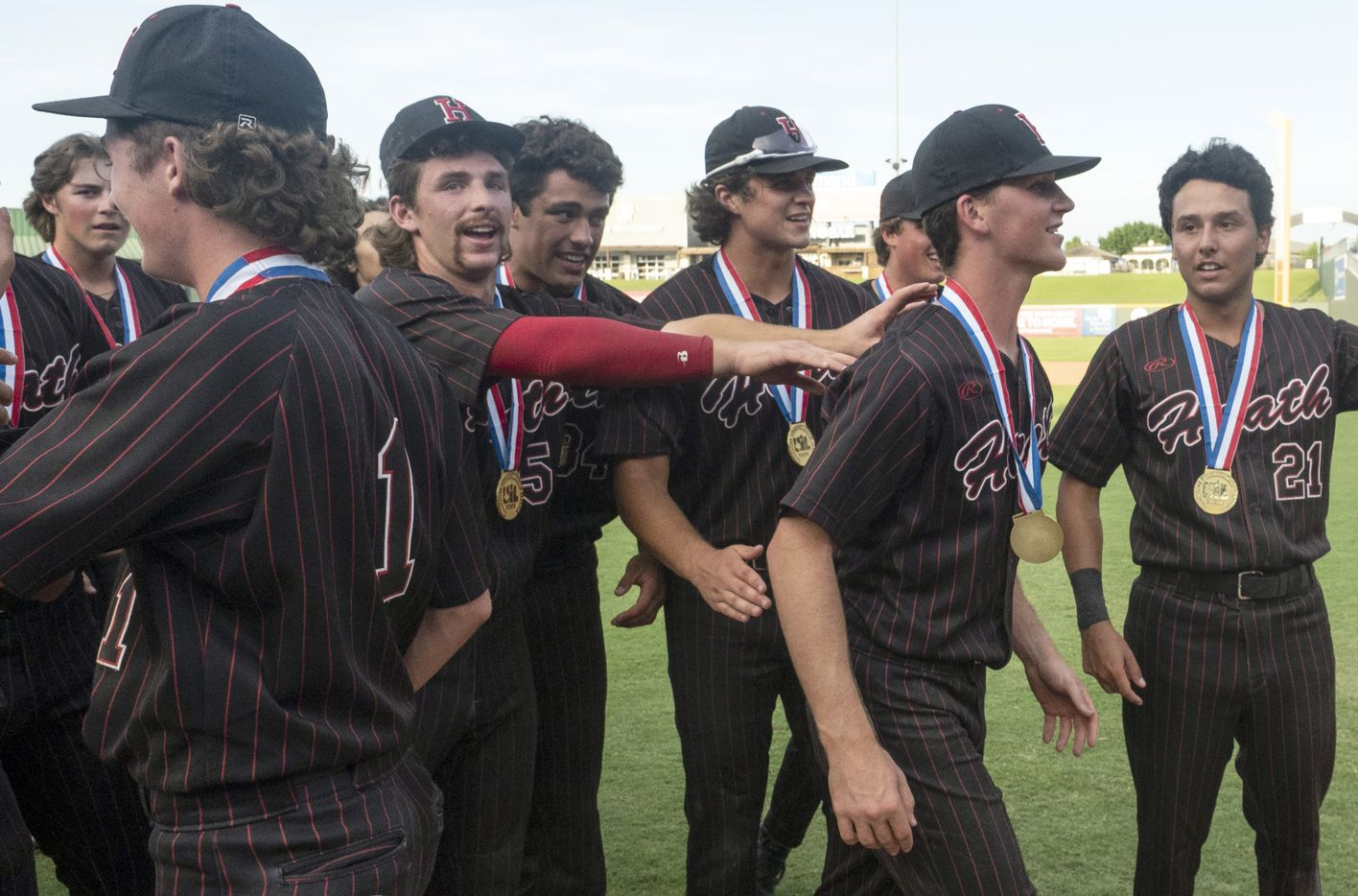 Tournament MVP Rockwall-Heath Caden Fiveash, (16), is pushed by teammates towards home plate to receive his award after the team defeated Keller in the 2021 UIL 6A state baseball final held, Saturday, June 12, 2021, in Round Rock, Texas.  Rockwall-Heath defeated Keller 4-3.   (Rodolfo Gonzalez/Special Contributor)
