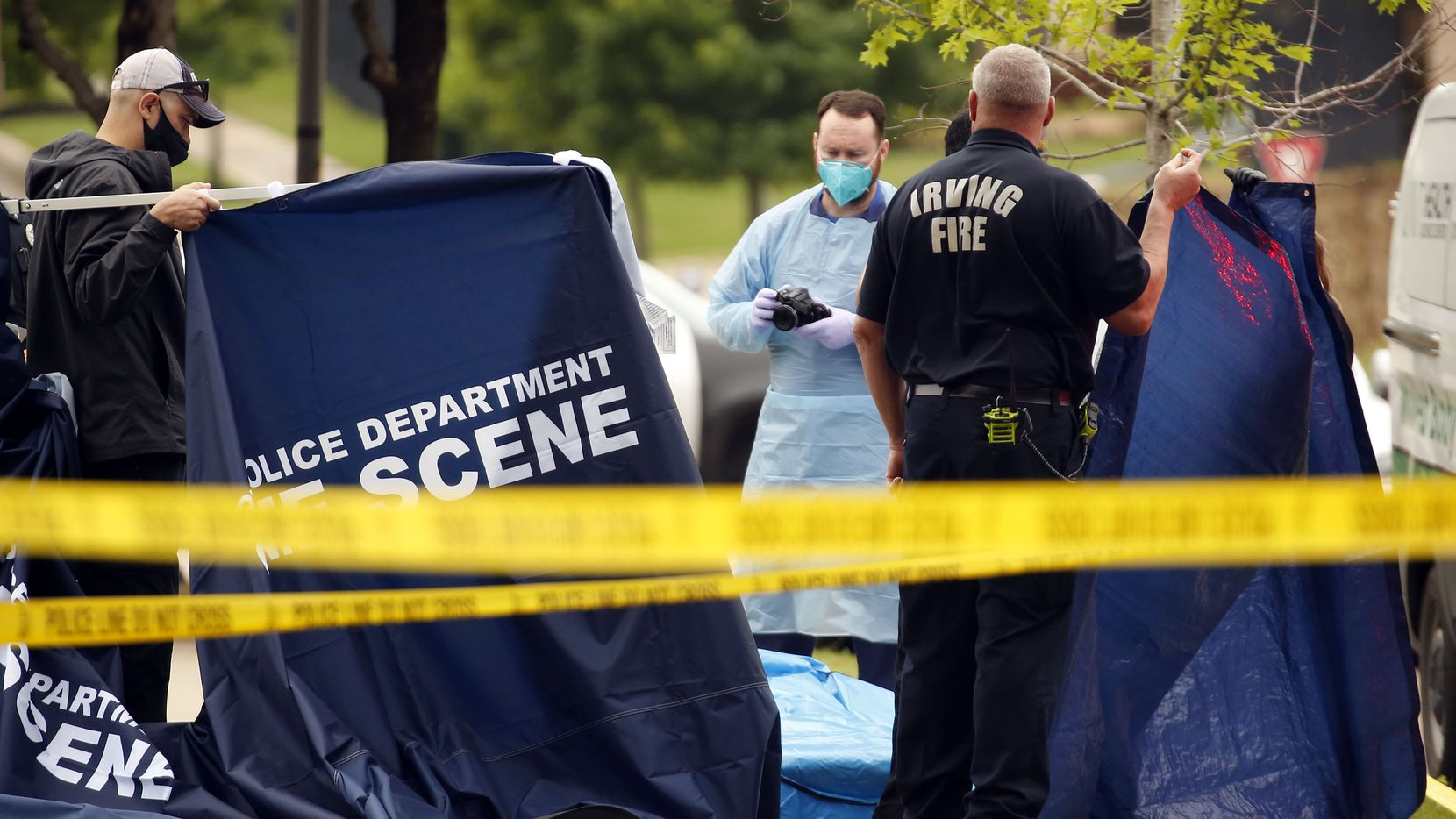 Irving Fire Department personnel and members of the medical examiners office inspect a woman recovered in the canal connected to Lago de Claire lake where Lashun Massey went missing near her Las Colinas home in Irving, Texas, Tuesday, April 27, 2021. The Texas Department of Transportation dive team located the woman who was wearing clothes matching the description of the reigning Mrs. Dallas pageant queen. Massey, 38, was last seen between 5:30 and 7 a.m. Tuesday walking near Lago de Claire, a small body of water close to Riverside Drive and East Royal Lane. She was wearing a black hoodie and checkered pajama pants. (Tom Fox/The Dallas Morning News)