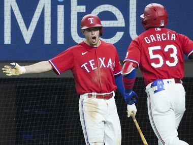 Texas Rangers center fielder Adolis Garcia celebrates second baseman Nick Solak after hitting a solo home run to tie the game during the seventh inning against the Minnesota Twins at Globe Life Field on Friday, June 18, 2021.