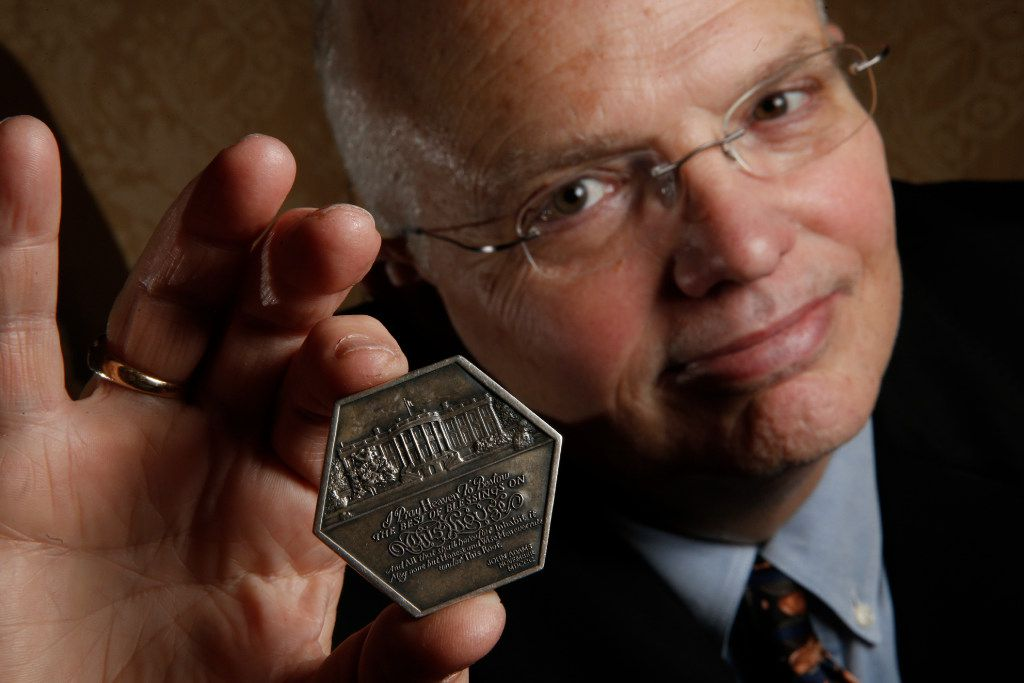 Hervey Priddy with a special edition Ronald Reagan presidential inauguration medal. (Nathan Hunsinger/Staff Photographer)