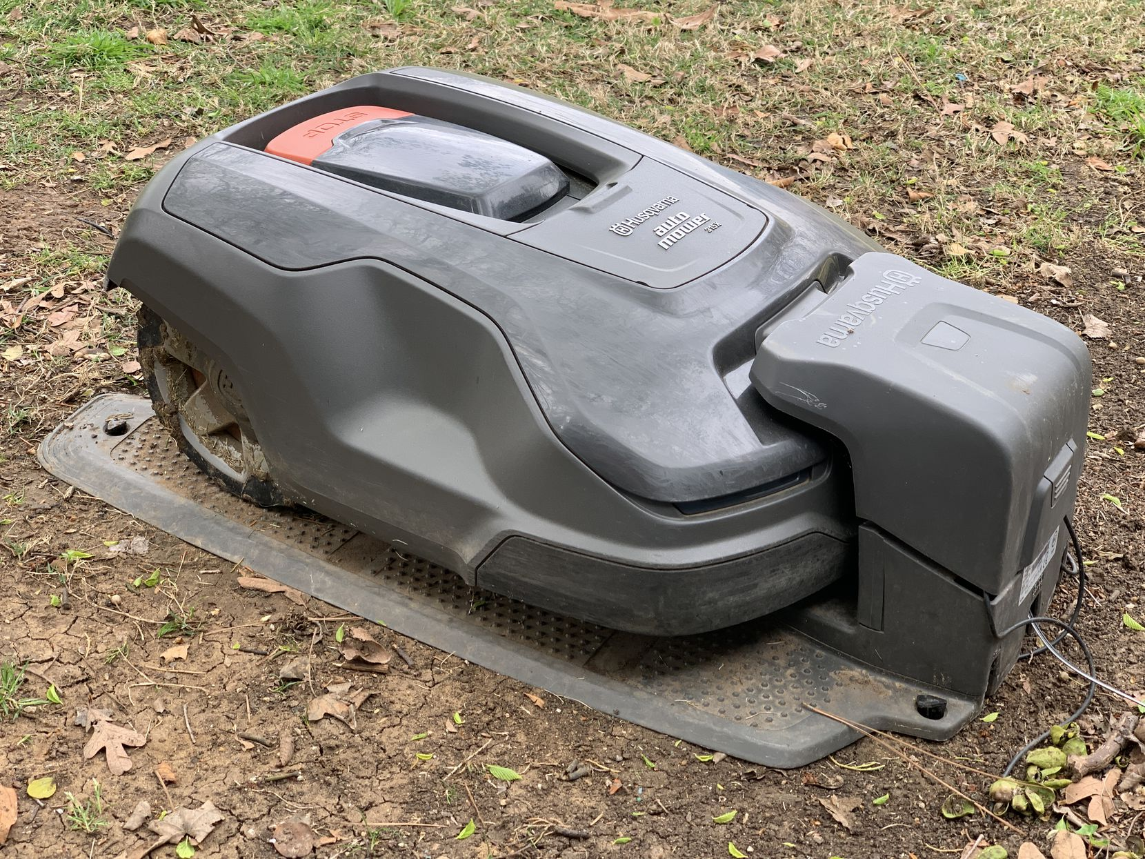The Husqvarna Automower 315X in its charging base.