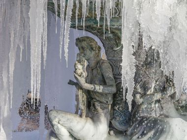 Icicles hang from a fountain at the The Village at Sports Center shopping center in Arlington.