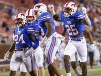 Southern Methodist Mustangs celebrate a tackle during the kick off return during the fourth quarter of a game against the Tulane Green Wave on Thursday, Oct. 21, 2021, at Gerald J. Ford Stadium on the campus of SMU in Dallas.