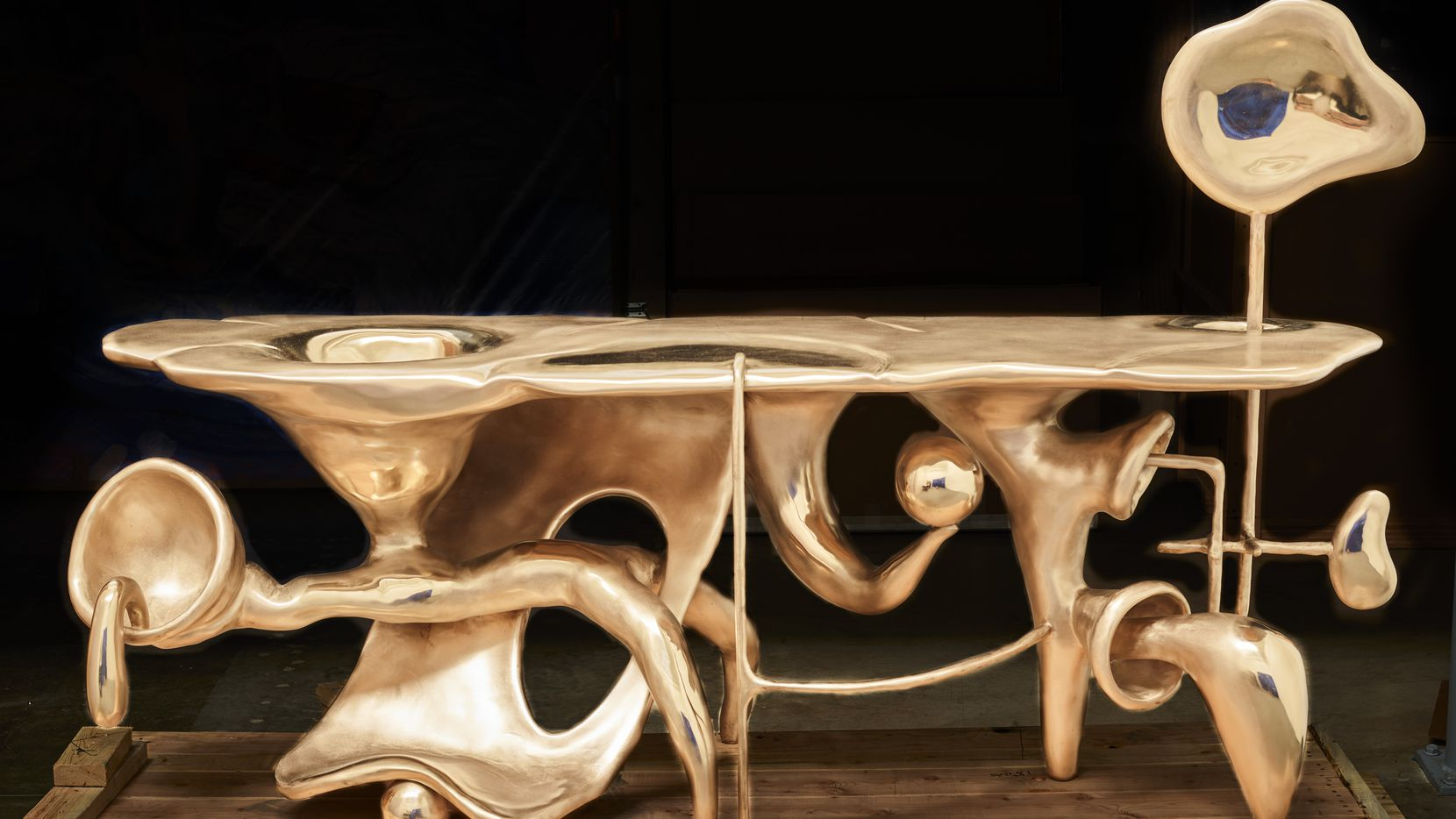 """Misha Kahn's madcap """"Tingle Tangle Mingle Mangle,"""" designed in 2017 and cast in bronze in 2019 by the Bollinger Atelier, is a Rube Goldbergian laboratory table where Duchamp and Giacometti's biomorphic surrealism collide with Dr. Seuss and the Flintstones."""