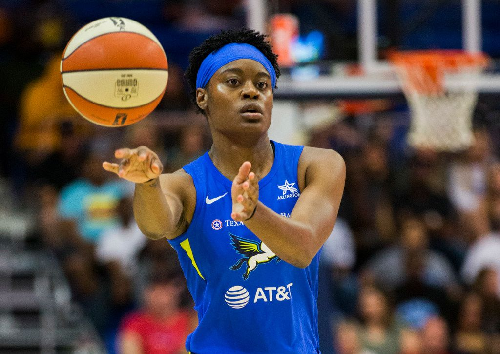 Dallas Wings guard Kaela Davis (3) makes a pass during the second quarter of a WNBA game between the Dallas Wings and the Indiana Fever on Friday, July 5, 2019 at UTA's College Park Center in Arlington. (Ashley Landis/The Dallas Morning News)