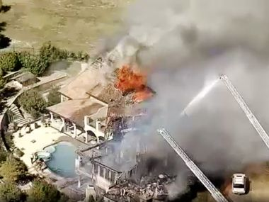 A $1.6 million mansion owned by Dr. Mark Kuper and his wife, Melissa Kuper, burns on October 26, 2017, in Benbrook.