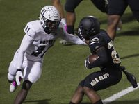 South Oak Cliff running back Cam Davis (25) is cornered by Mesquite Poteet linebacker Malek Harrison (31) during a first quarter rush.The two teams played their District 6-5A Division 1 football game at Kincaide Stadium in Dallas on October 30, 2020.