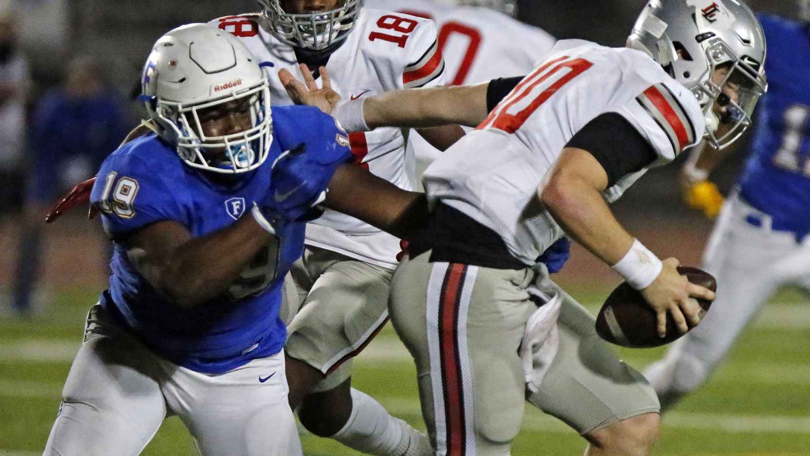 Lovejoy quarterback R.W. Rucker (10) is chased by Frisco defensive end Kenmunta Miller (19) during the first half of a game at Frisco ISD Memorial Stadium on Friday, Nov. 20, 2020. (Stewart F. House/Special Contributor)