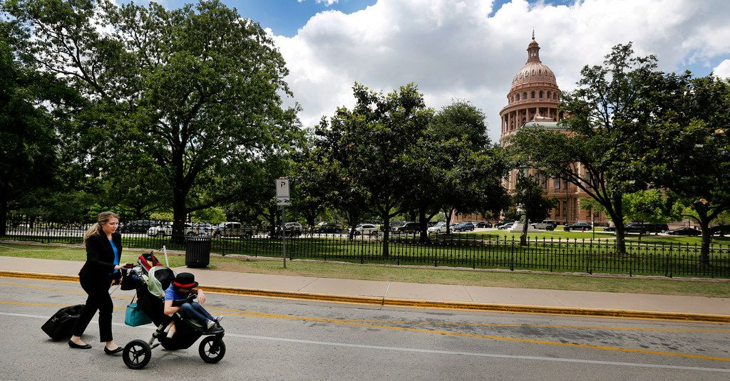 Hannah Mehta, pushing her nine yr-old son Aiden in a stroller and dragging a rolling case of health care information, heads for the Texas State Capitol in Austin Wednesday, April 19, 2017 to visit with lawmakers about upcoming legislation related to healthcare funding for medically dependent children. Since last May, Mehta, a Flower Mound resident and mother of triplets, has been making weekly trips to Austin on behalf of Protect Texas Fragile Kids, a nonprofit leading the fight against the addition of the Medically Dependent Children's Program to STAR Kids. (Tom Fox/The Dallas Morning News)