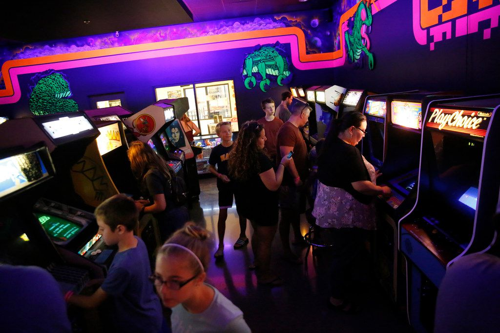 People play video games at the National Videogame Museum in Frisco on Aug. 2, 2018. (Rose Baca/The Dallas Morning News)