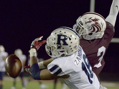 Red Oak's Elijah Shaw (3) knocks away a pass intended for Richland's Mark Zamora (18)  in the first quarter of a high school football game between Richland and Red Oak, Friday, Oct. 30, 2020, in Red Oak, Texas.