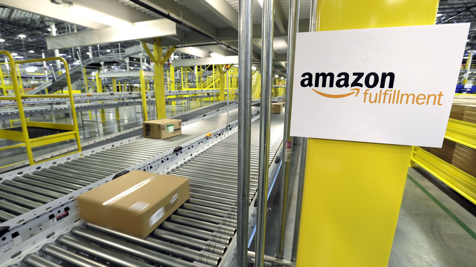 A package moves along a conveyer belt at an Amazon.com fulfillment center in DuPont, Wash.