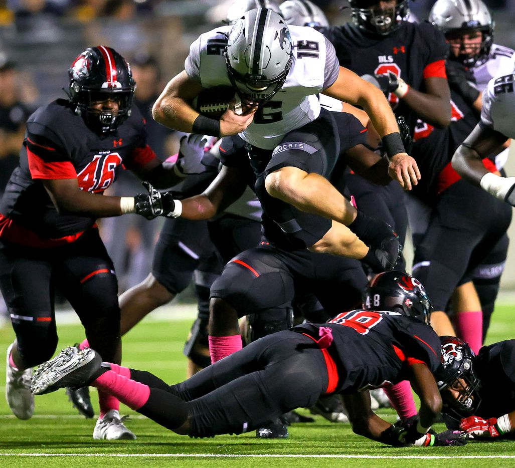 Denton Guyer running back Jackson Foster (16) leaps over Denton Braswell defensive back Ayoub Githii (48) for a few yards during the first half in a District 5-6A high school football game played at the C.H. Collins Complex on Friday, October 8, 2021, in Denton. (Steve Nurenberg/Special Contributor)