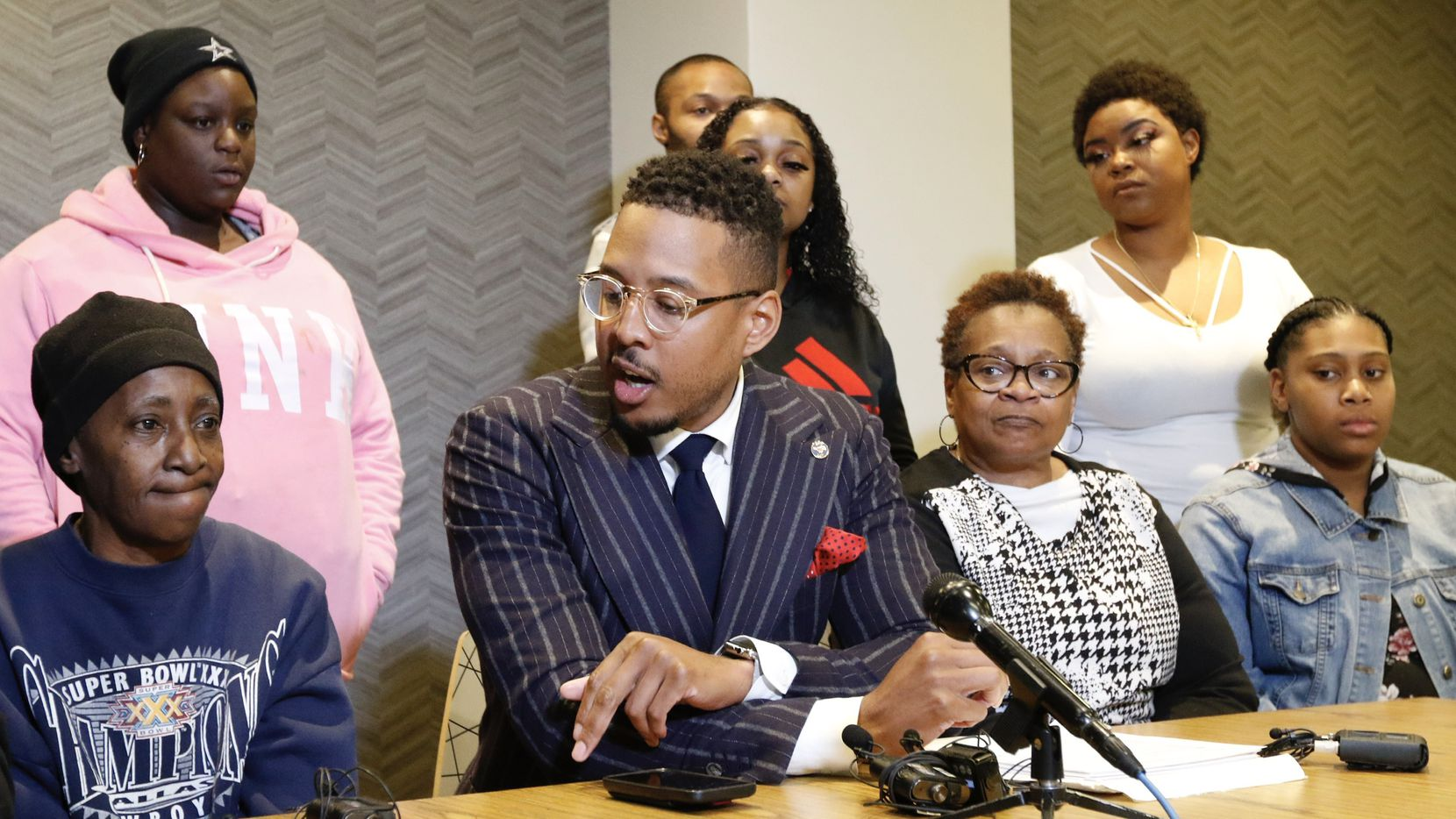 """Ethelyn Ross, left, mother of Diamond Ross, and other family members listen to attorney Justin Moore, center, talk about the video on Friday morning, November 8, 2019 in Dallas, Texas. Dallas police released """"disturbing"""" videos late Wednesday that show the final hours of Diamond S. Ross, a 34-year-old woman who died in police custody of an overdose in 2018. (Irwin Thompson/The Dallas Morning News)."""
