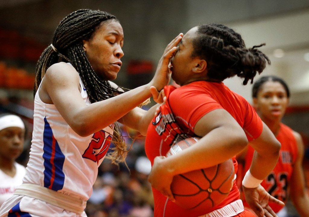 Duncanville's Anaya Bernard (20, left) inadvertently smashes Cedar Hills' Portia Adams (11) in the face as they fought for a rebound during the first half of the Class 6A Region I championship game at Wilkerson-Greines Activity Center in Fort Worth, Saturday, February 29, 2020. (Tom Fox/The Dallas Morning News)