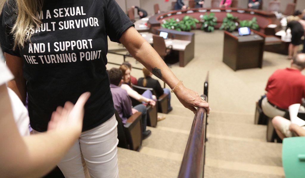A supporter of The Turning Point rape crisis center waited Monday night to speak at a Plano City Council meeting.
