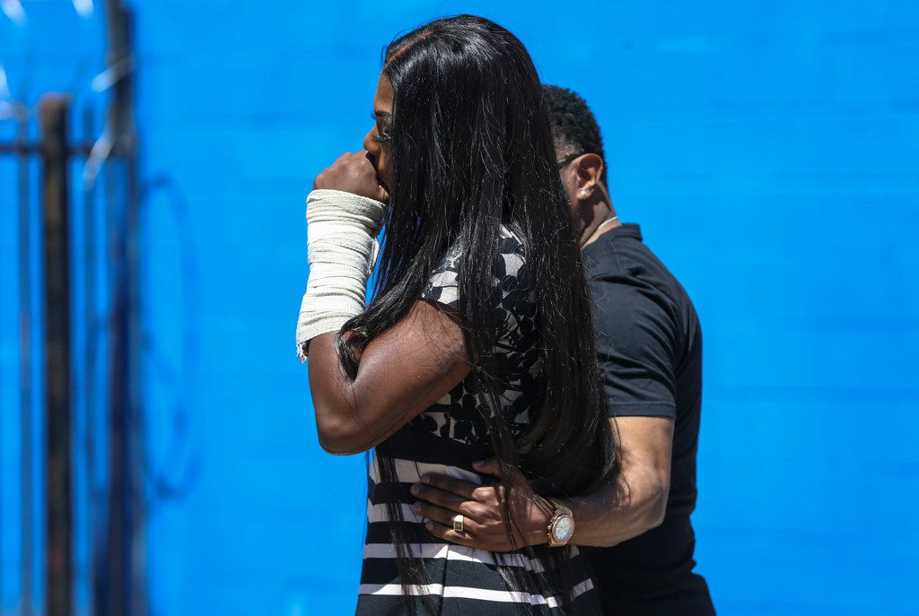 A supporter hugs Muhlaysia Booker after she spoke at Saturday's rally.