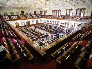 Democrats gathered around the podium as they spoke in opposition to Senate Bill 7 in the House Chamber at the Texas Capitol during the 87th Texas Legislature on May 7, 2021.