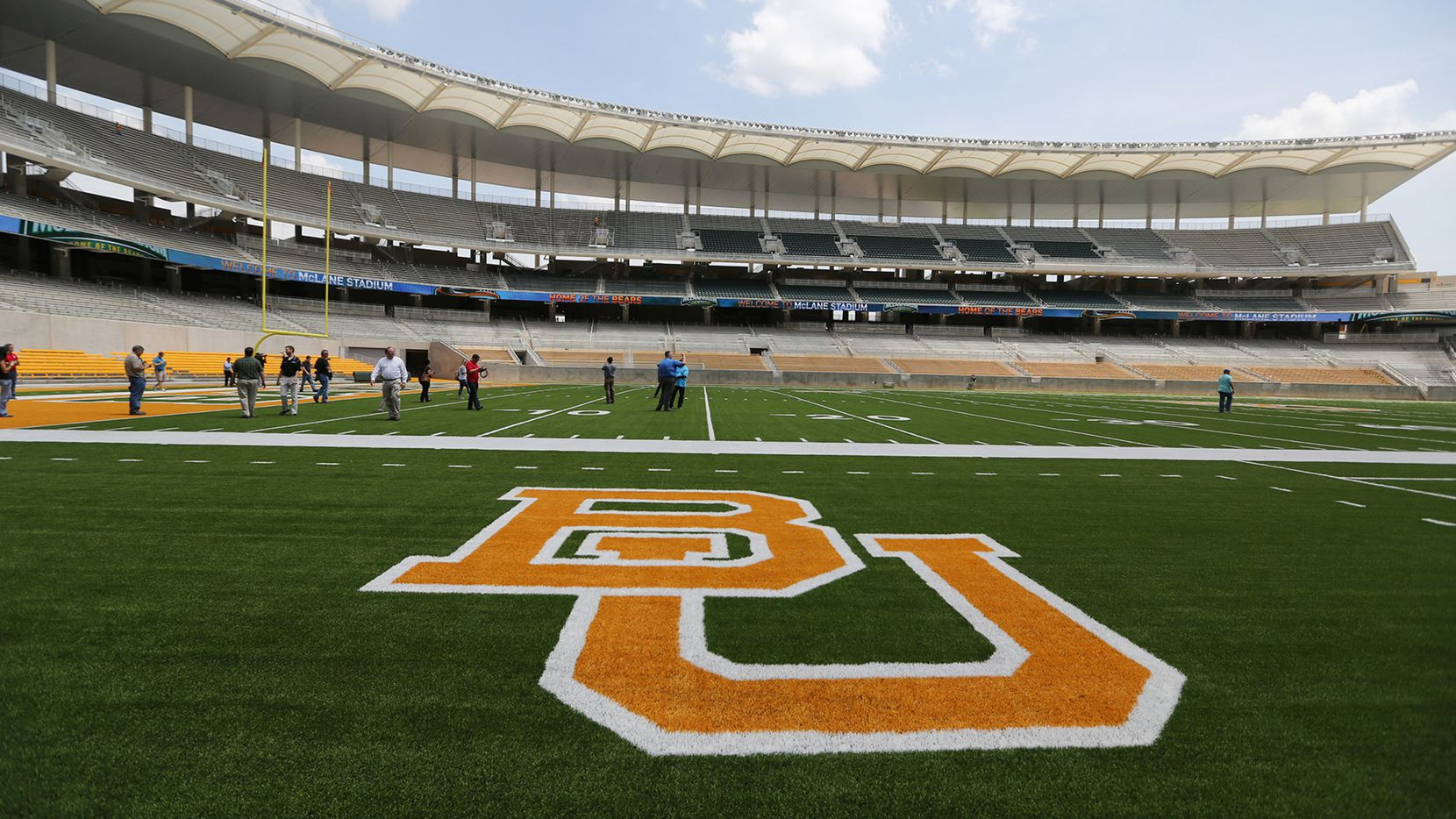 FILE - This Aug. 18, 2014 file photo shows the Baylor University logo on the football field at McLane Stadium in Waco, Texas.
