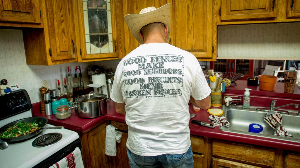 "A firm believer in the power of well-made biscuits, Mike Newton, known as the Cowboy Chef, works in what he calls his ""ugly kitchen"" in his ranch house in Lipan, Texas on July 17, 2018. (Robert W. Hart/Special Contributor)"