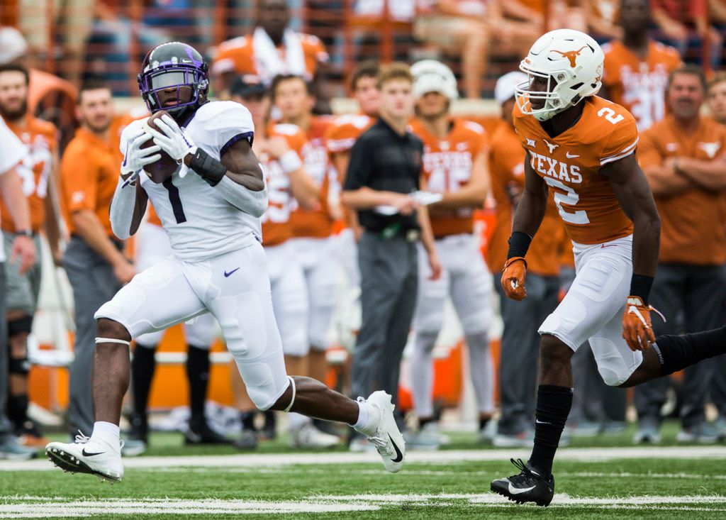 FILE - TCU Horned Frogs wide receiver Jalen Reagor (1) catches a pass ahead of Texas Longhorns defensive back Kris Boyd (2) during the first quarter of a college football game between TCU and the University of Texas on Saturday, September 22, 2018 at Darrell K Royal - Texas Memorial Stadium in Austin. (Ashley Landis/The Dallas Morning News)
