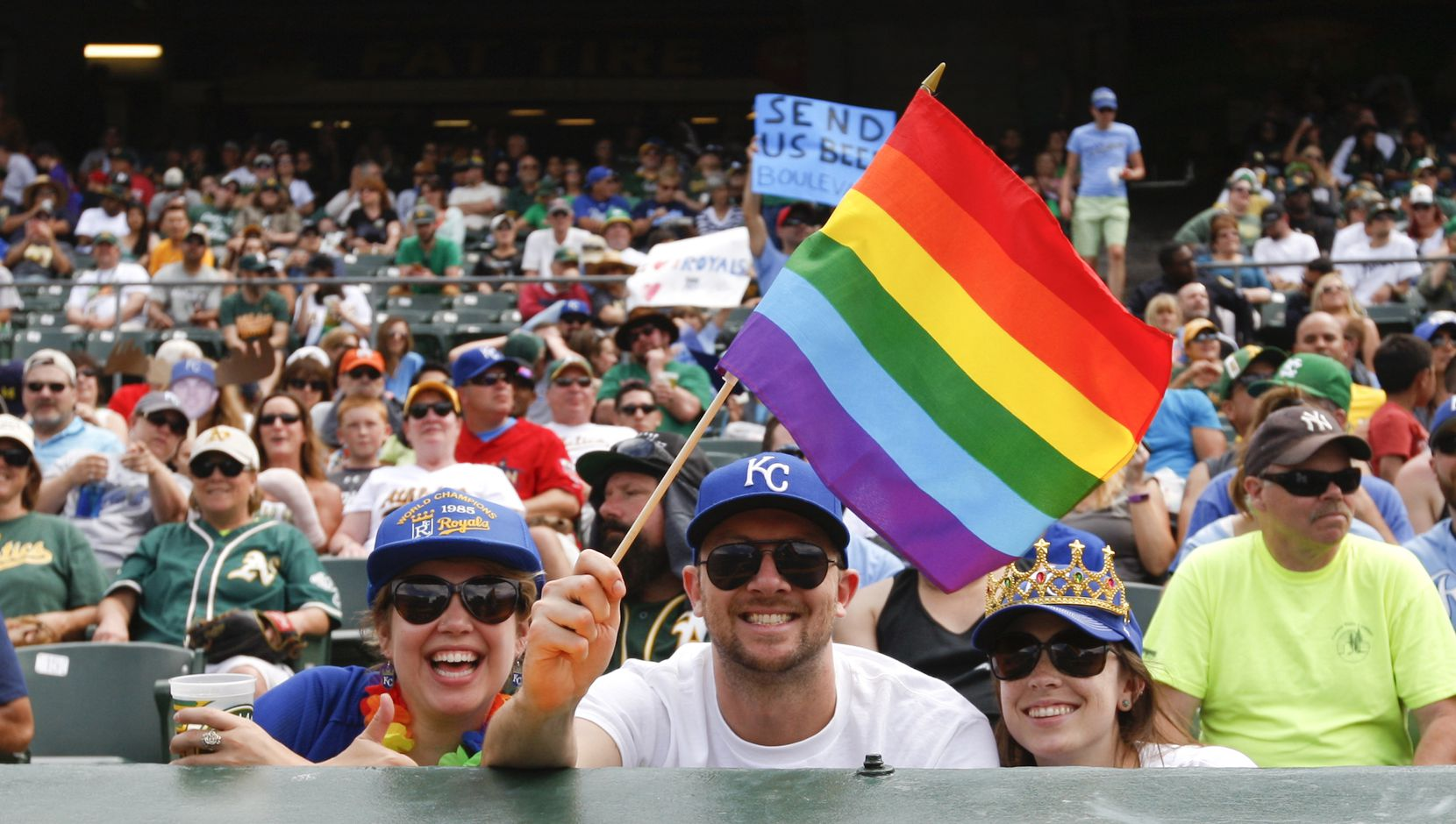 Fans celebrate Pride Weekend during the game between the Oakland Athletics and the Kansas City Royals at O.co Coliseum on June 27, 2015 in Oakland, California. The Royals defeated the Athletics 3-2.