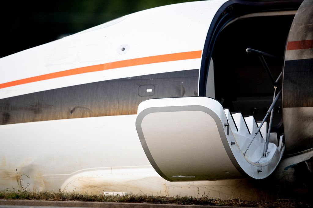 The stairs to a small airplane in which NASCAR driver Dale Earnhardt Jr., his wife and daughter were passengers is seen after a crash near Elizabethton Municipal Airport in Elizabethton, Tenn., Thursday, Aug. 15, 2019. Earnhardt will take the weekend off from broadcasting to be with his wife and daughter. The 44-year-old television analyst and retired driver was taken to a hospital for evaluation after the crash in east Tennessee. (Calvin Mattheis/Knoxville News Sentinel via AP)