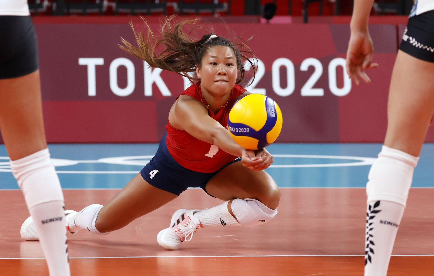 USA's Justine Wong-Orantes (4) digs for the ball in a volleyball game against Argentina during the postponed 2020 Tokyo Olympics at Ariake Arena on Sunday, July 25, 2021, in Tokyo, Japan. USA defeated Argentina 3-0 (25-20, 25-19, 25-20). (Vernon Bryant/The Dallas Morning News)