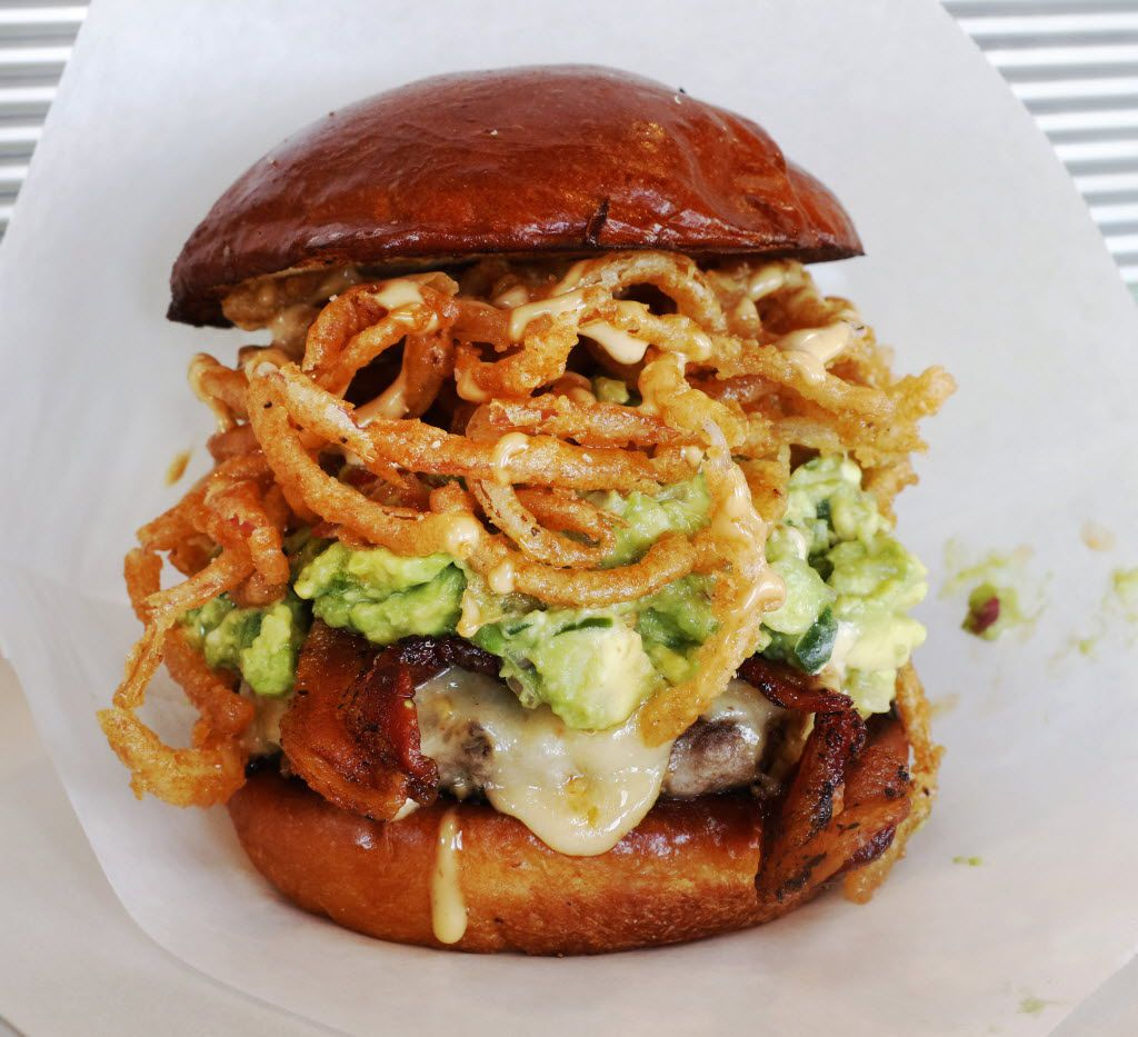 The Dale's Revenge burger at Pints & Quarts has crispy onion strings, habanero cheese, chunky guacamole, bacon and secret sauce.