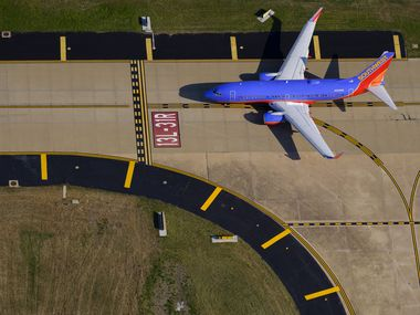 A Southwest Airlines 737-7H4 holds short of the runway at Dallas Love Field.
