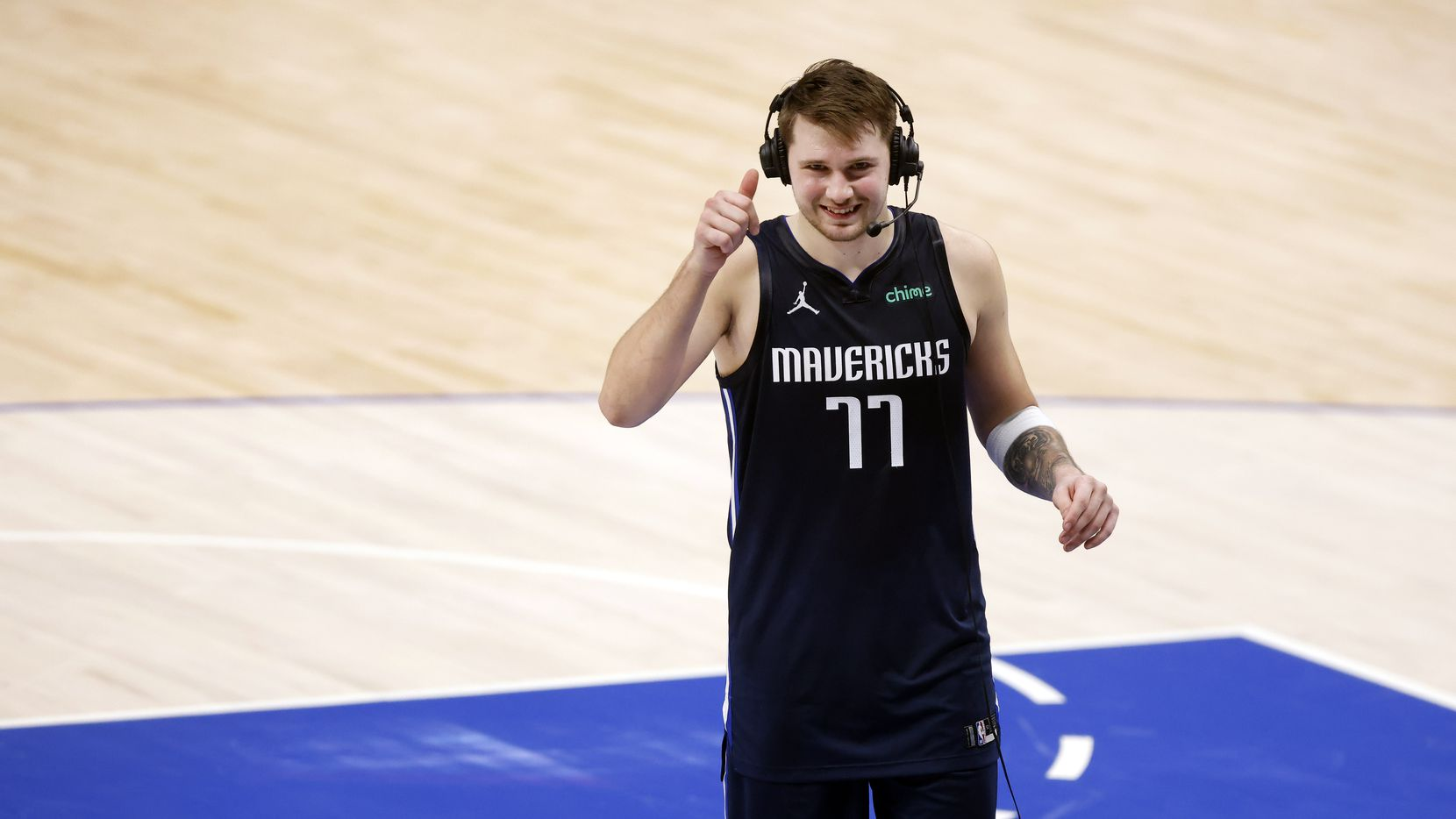 Dallas Mavericks guard Luka Doncic (77) gives a thumbs up to the television camera as he does a psot-game interview following their win over the Boston Celtics at the American Airlines Center in Dallas, Tuesday, February 23, 2021.
