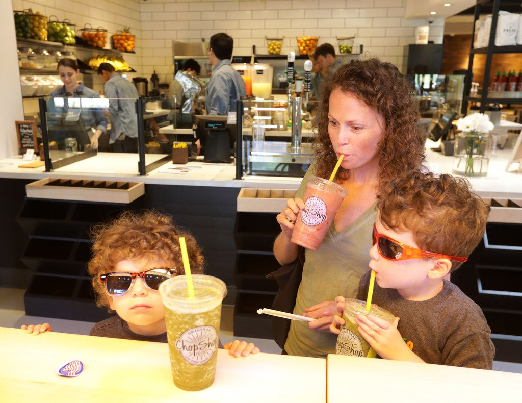 2-year-old Levi Taplin, left, Savannah Taplin, and 6-year-old Gavin Taplin enjoy drinks at Original Chop Shop in Plano, TX, on Jun. 13, 2019. (Jason Janik/Special Contributor)