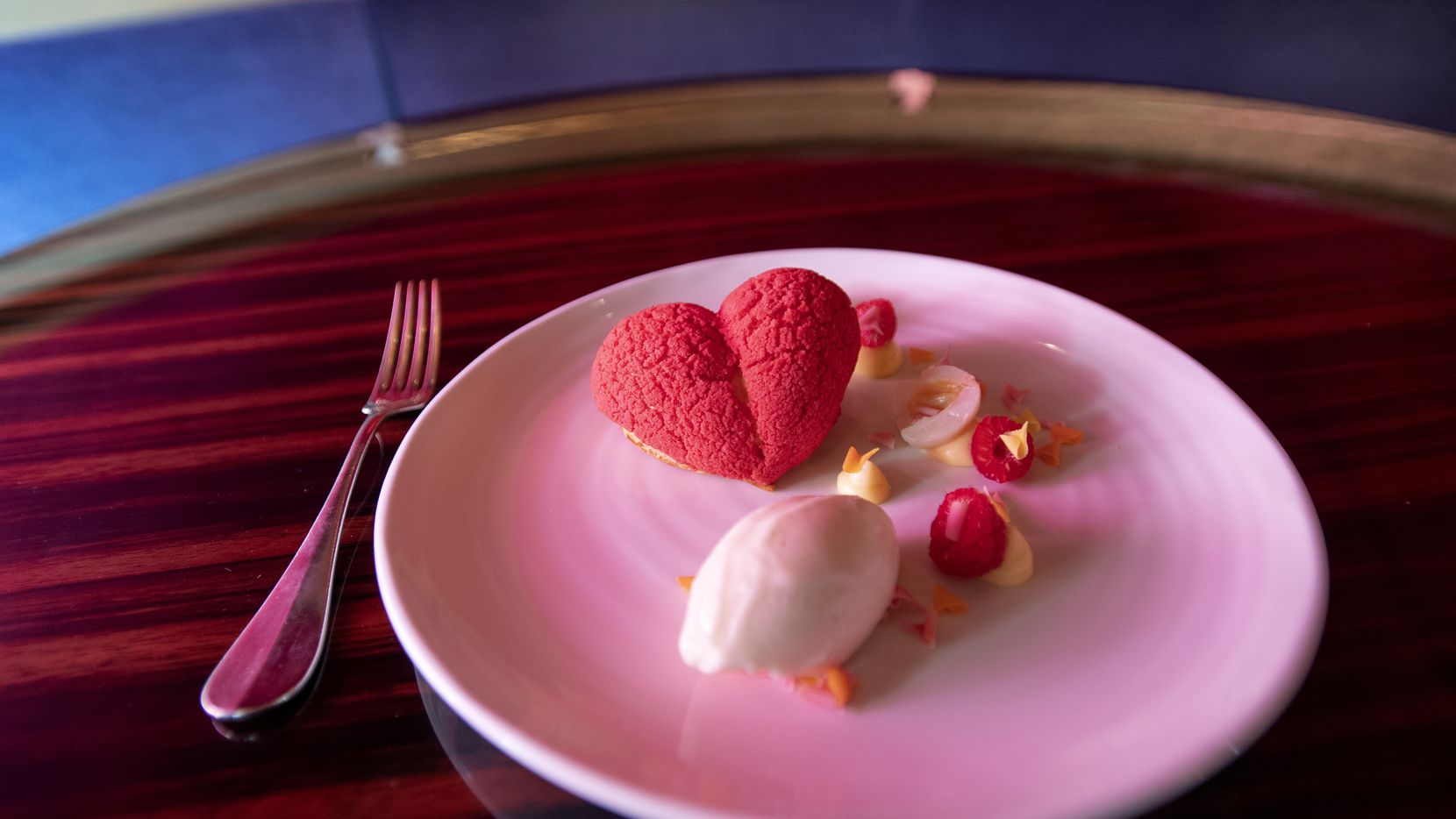 Coeur de Choux à la framboise is served at Bullion, Feb. 6, 2020, in downtown Dallas. The dessert dish, which will be served as part of the restaurant's four-course Valentine's Day dinner, includes chocolate raspberry crémeux, lychee and raspberry sorbet.