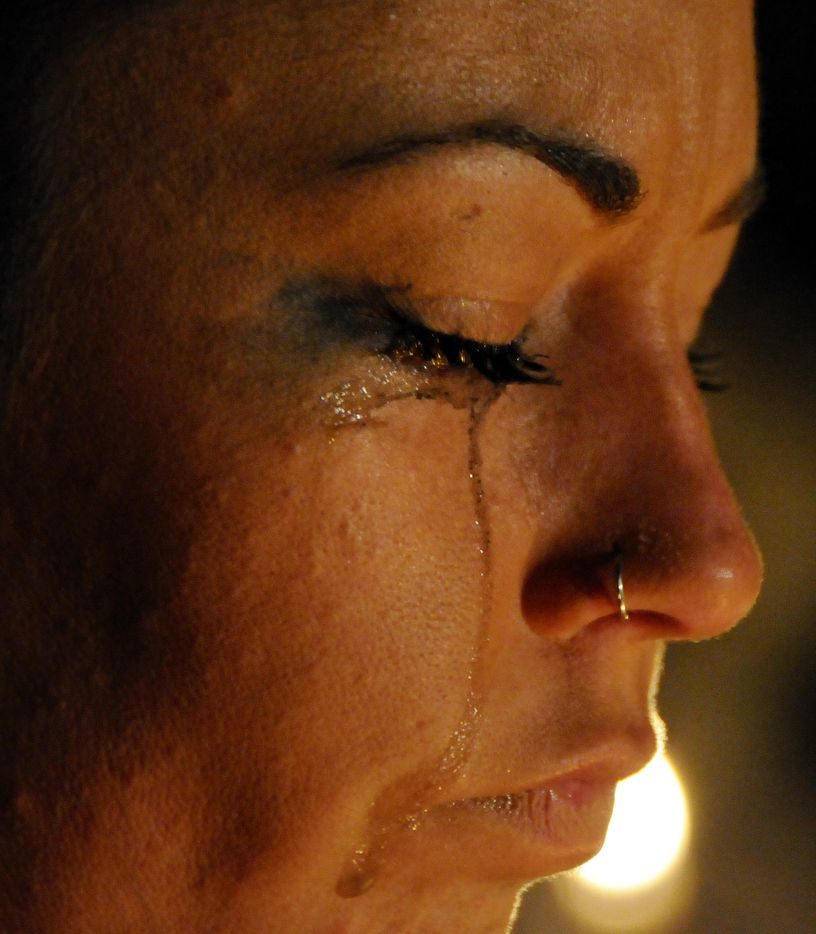 Tears run down the face of Cassie Freeman, 23, a friend of Amber Hagerman, at a candlelight vigil held Jan. 13, 2011 in Arlington, TX in the parking lot where Amber Hagerman was abducted exactly 15 years earlier. She was found dead four days later but her killer has never been caught.