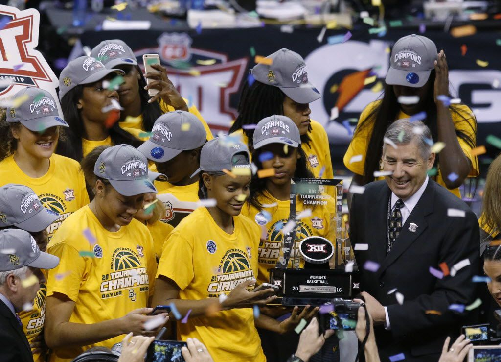 The Baylor team is presented the championship trophy by Bob Bowlsby, right, Big 12 commissioner, following an NCAA college basketball championship game against Texas in the Big 12 women's tournament in Oklahoma City, Monday, March 7, 2016. Baylor won 79-63. (AP Photo/Sue Ogrocki)