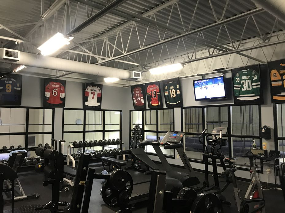 Ben Bishop and Matthew Tkachuk's jerseys are framed at Elevated Performance in St. Louis.